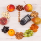 Glucose meter with fruits in shape of clock, time for healthy food for diabetics containing minerals - PhotoDune Item for Sale