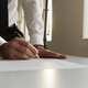 Businessman in office signing contract, document or legal papers - PhotoDune Item for Sale