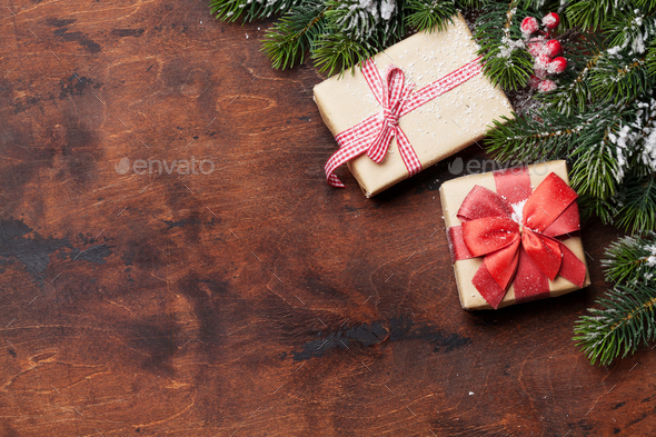 Christmas gift boxes and fir tree branch - Stock Photo - Images