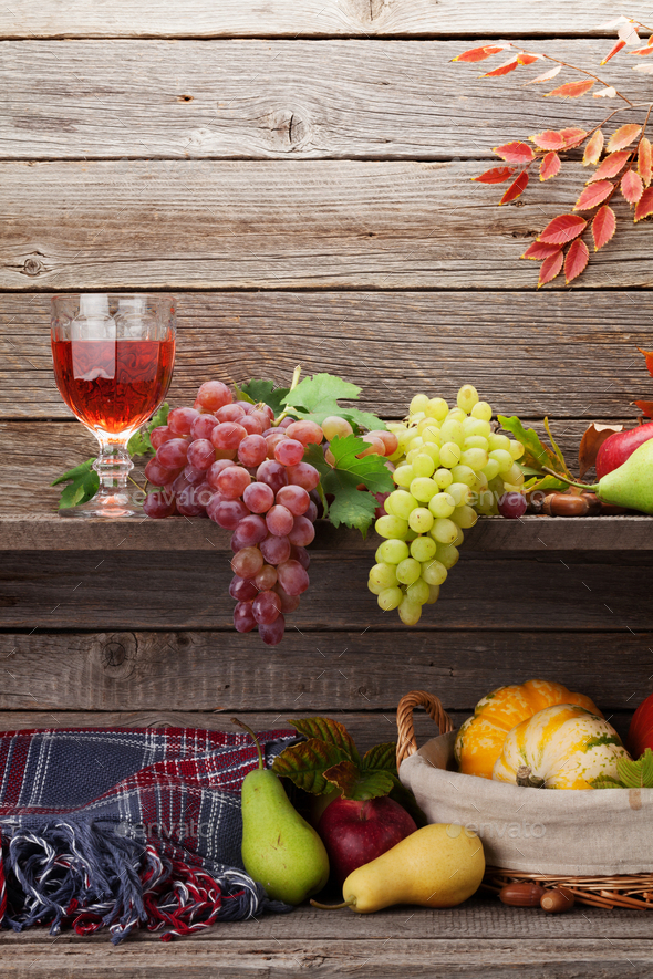 Autumn card with pumpkins, fruits and wine - Stock Photo - Images