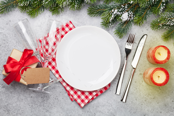 Christmas table setting with champagne and xmas gift - Stock Photo - Images