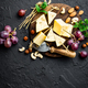 Cheese with grape and nuts on wooden board - PhotoDune Item for Sale