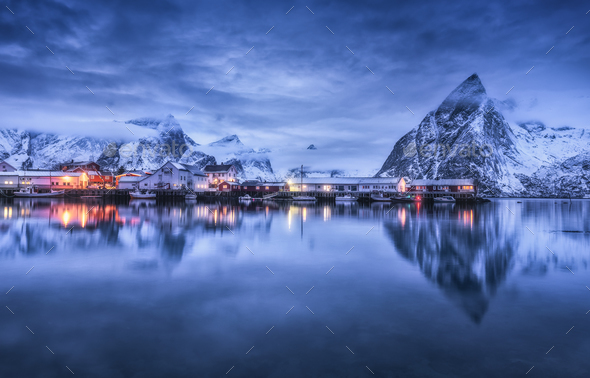 Beautiful fishing village with boats at night, Lofoten islands - Stock Photo - Images
