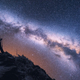 Space with Milky Way and silhouette of a woman with backpack - PhotoDune Item for Sale