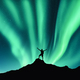 Northern lights and silhouette of standing happy man. Aurora - PhotoDune Item for Sale