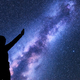 Milky Way. Silhouette of a happy woman. Space - PhotoDune Item for Sale