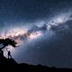 Milky Way and silhouette of woman under the tree - PhotoDune Item for Sale