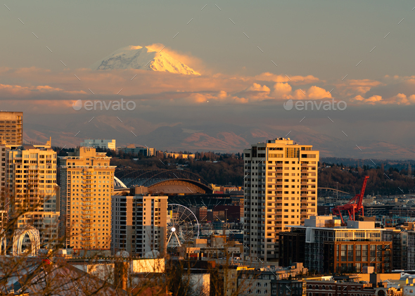 Fighter Jet Flies Over Seattle in the Distance during Mount Rainier Sunset - Stock Photo - Images