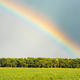 Storm Swirling Generates Rainbow as Sun Comes out over Farmland - PhotoDune Item for Sale