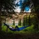 Girl rests on a Hammock looks at Dallas Peak near Lower Blue Lak - PhotoDune Item for Sale