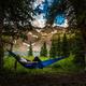 Girl rests on a Hammock looks at Dallas Peak near Lower Blue Lak - PhotoDune Item for Sale