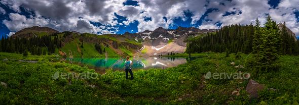 Hiker looks at Blue Lake Ridgway Colorado - Stock Photo - Images