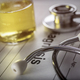 Vial of medication along with a stethoscope, conceptual image - PhotoDune Item for Sale