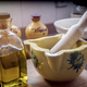 Traditional ceramic mortar next to a bottle of olive oil in a kitchen, traditional cooking utensils - PhotoDune Item for Sale