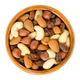 Nuts and raisins in wooden bowl over white - PhotoDune Item for Sale