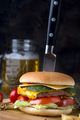 delicious homemade burger used to chop beef. on the wooden table. The burgers are inserted knives - PhotoDune Item for Sale