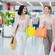 Shopping women talking happy holding shopping bags having fun laughing. Two beautiful young woman - PhotoDune Item for Sale