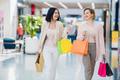 Shopping women talking happy holding shopping bags having fun laughing. Two beautiful young woman - PhotoDune Item for Sale