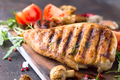 Grilled chicken fillets on wooden board on Gray concrete background. Healthy diet food concept - PhotoDune Item for Sale