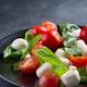 Tasty and beautiful Caprese salad on the black ceramic plate, close up - PhotoDune Item for Sale