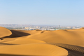desert and city, shanshan county kumtag desert,xinjiang, China - PhotoDune Item for Sale