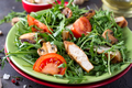 Close-up on a salad with chicken and tomato on green ceramic plate in a stone table. Healthy diet - PhotoDune Item for Sale