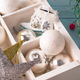 Christmas wooden tray with toys. Antique stars and balls on wooden table. Close up - PhotoDune Item for Sale