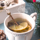Winter time. Cup of hot tea with lemon, christmas toys and woolen scarf. Close up - PhotoDune Item for Sale