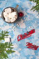 Christmas winter still life : a cup of cocoa with marshmallows sprinkled with nuts , fir cones on a - PhotoDune Item for Sale