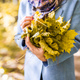 Nature, beauty, people concept - close up of woman with a colorful bouquet of yellow autumn leaves - PhotoDune Item for Sale