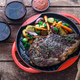 Grilled Beef Steak on grill iron pan on wooden background - PhotoDune Item for Sale