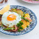 Fried egg with potato and jamon ham, spain cuisine, close view - PhotoDune Item for Sale