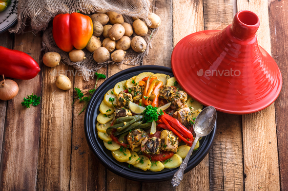 Chermoula fish tajine with bell peppers, moroccan cousine. - Stock Photo - Images