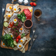 Cutting board with meat, eggs, vegetables, mushrooms, flat lay copy space. - PhotoDune Item for Sale