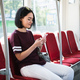 Girl on her phone while travelling on the bus - PhotoDune Item for Sale
