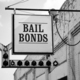 Aging Vintage Sign in Front of Samll Town Bail Bonds Office - PhotoDune Item for Sale