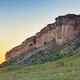 Vertical rocky wall at sunset with large boulders at the foot - PhotoDune Item for Sale