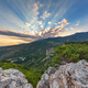 Rays of the sun passing through a cloud above the mountain - PhotoDune Item for Sale