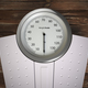 Analog weight scale on wood floor. - PhotoDune Item for Sale