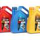 Motor oil canisters with different types of motor oil on white i - PhotoDune Item for Sale