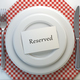 Reserved card on a restaurant table setting. Top view. Mock up. - PhotoDune Item for Sale