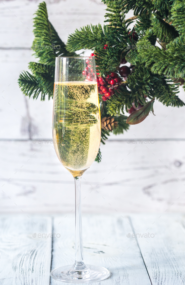 Glass of champagne with Christmas tree branch - Stock Photo - Images