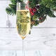 Glass of champagne with Christmas tree branch - PhotoDune Item for Sale