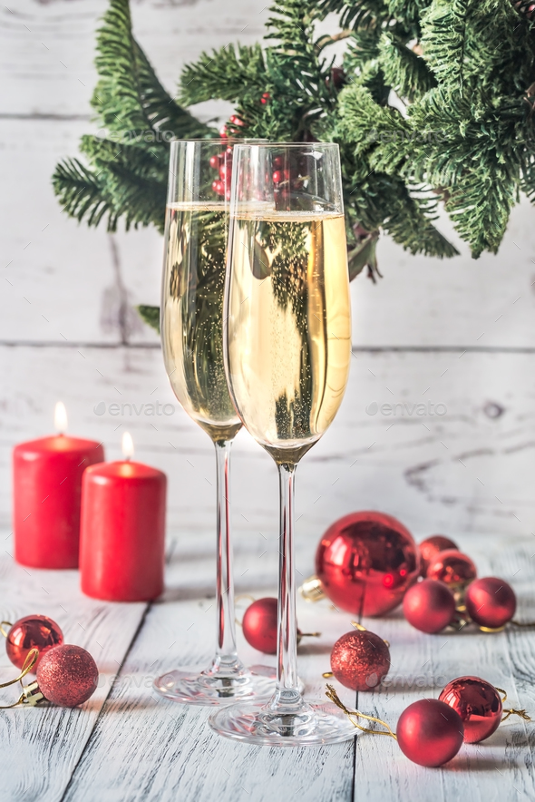 Two glasses of champagne with Christmas tree branch - Stock Photo - Images