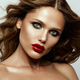 Beautiful face of a fashion model with blue eyes.Curly hair. Red lips - PhotoDune Item for Sale