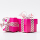 Two pink gift box tied with white red stripe ribbon - PhotoDune Item for Sale