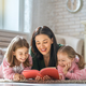 mother reading a book to her daughters - PhotoDune Item for Sale