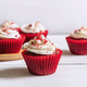 Red velvet cupcake on white wooden table - PhotoDune Item for Sale