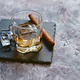 Glass of whiskey with ice cubes and cigar - PhotoDune Item for Sale