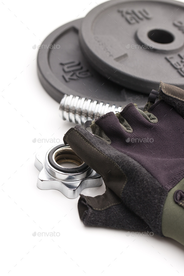 Dumbbell and fitness gloves. - Stock Photo - Images
